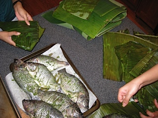 wrapping fish in banana leaves