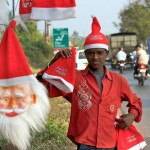 A vendor sells Christmas hats in India. 