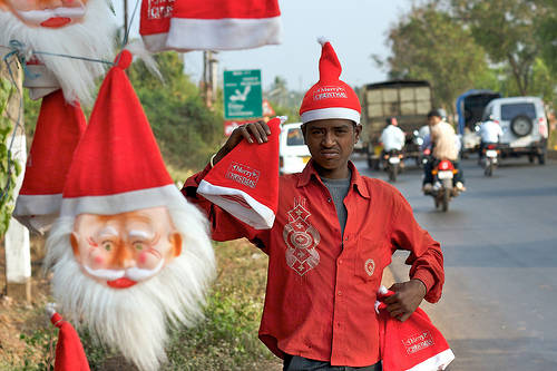 A vendor sells Christmas hats in India.  Photo by www.flickr.com user Mr Jon Ardern Esq.
