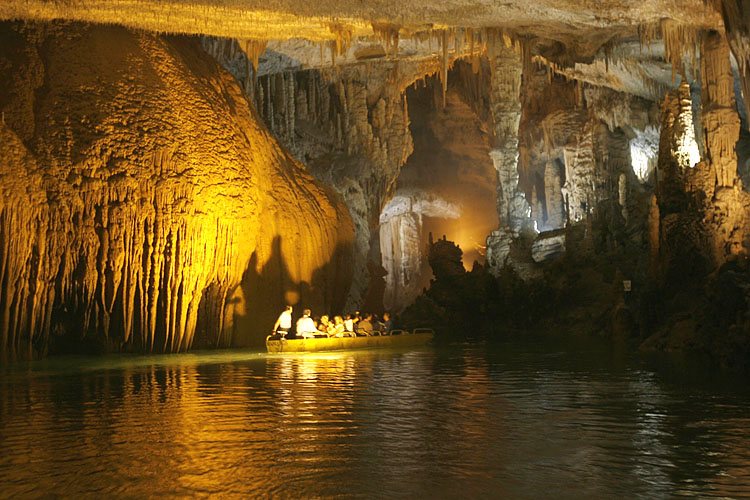 Lebanese journalists and photographers tour the Jeita Grotto by boat during a media day to campaign for the selection of the Jeitta Grotto as one of the seven natural wonders of the world