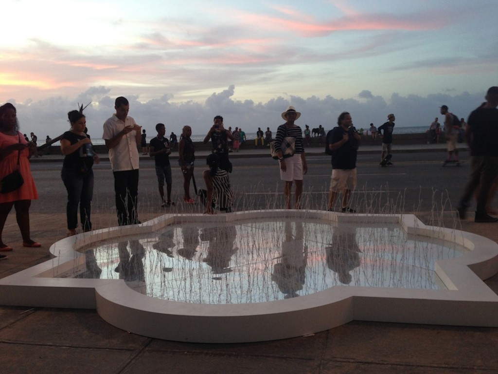 """Moroccan artist Safaa Erruas displayed a Moorish shaped fountain with hundreds of white barbed wire poles emerging from the center titled, """"Fuente de Espinas,"""" or Fountain of Thorns,"""" in English."""