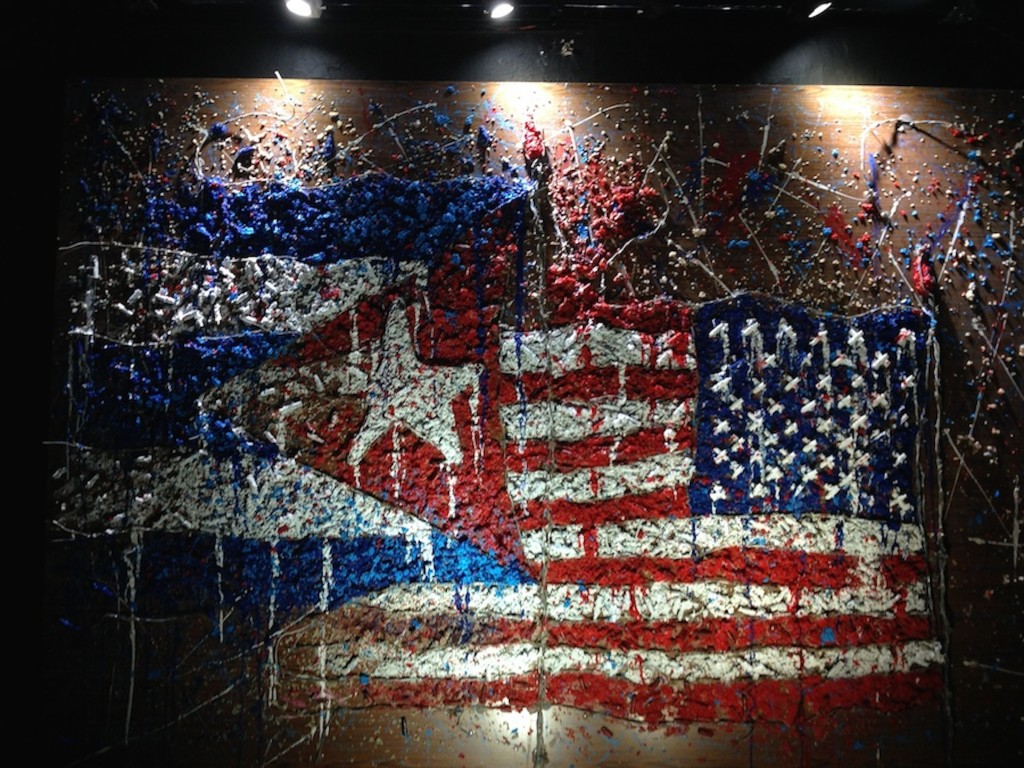Art piece displaying U.S. and Cuba flags at the Zona Franca exhibition, held inside the 18th-century fortress, La Cabaña during the 12th Havana Biennial.